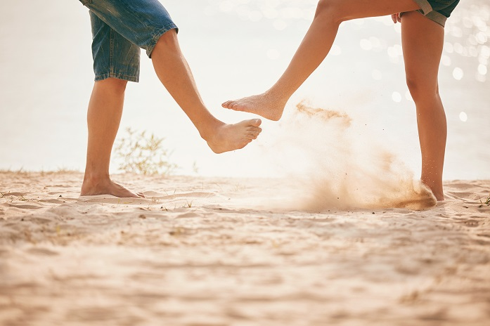 young couple playing with sand