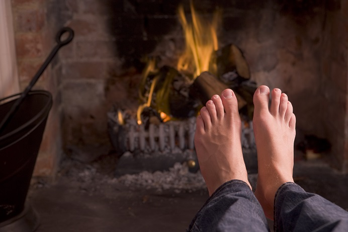 feet in front of a fireplace